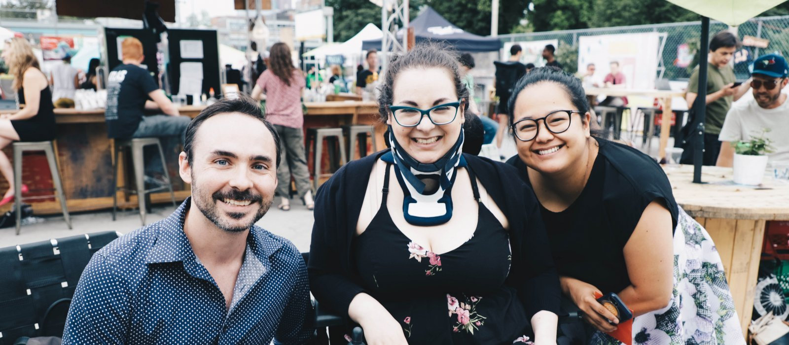 Accessibility Award winner Ophira Calof sits with Tyler Seguin at the Fringe Patio