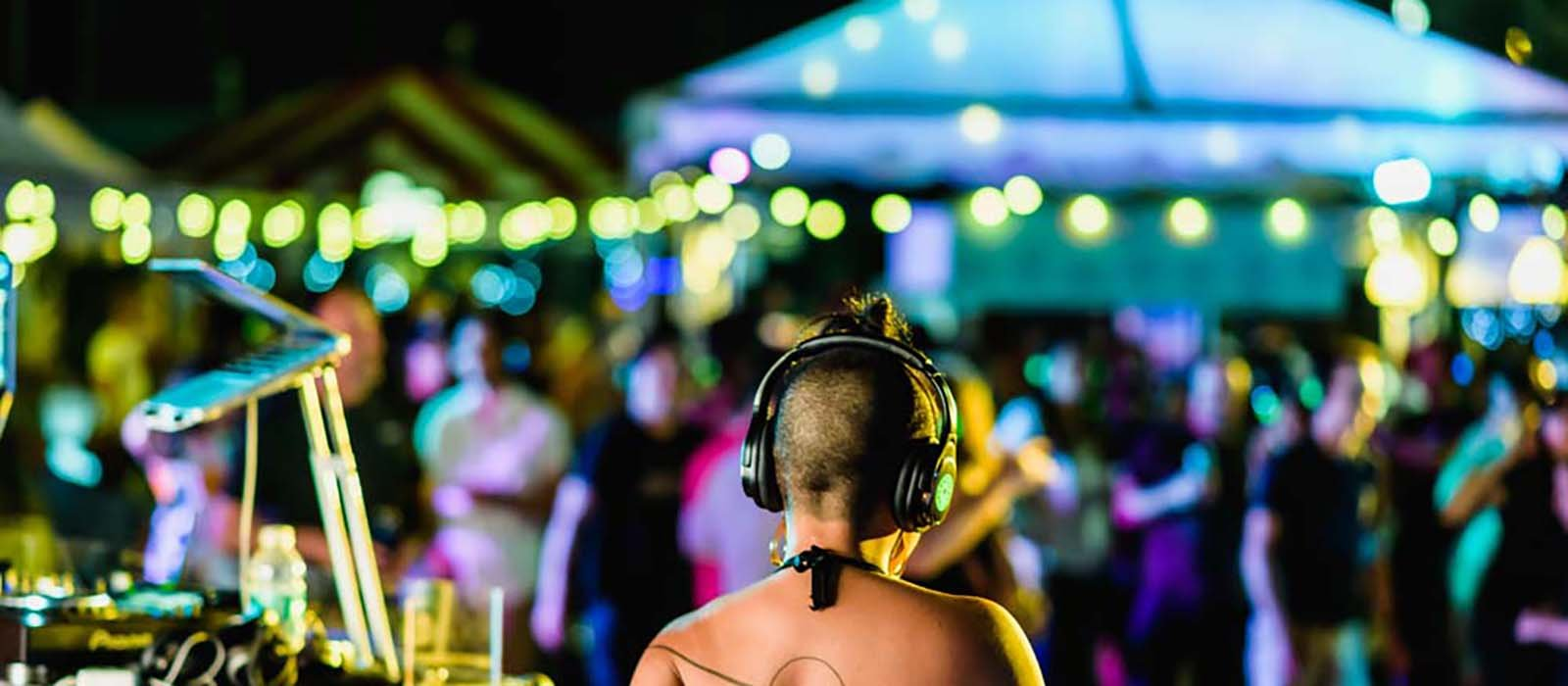 People listening to headphones at a silent disco